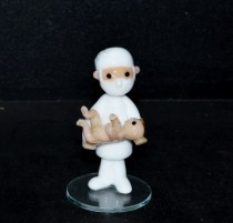 The doctor - an obstetrician with a baby. Size 6 to 8 cm