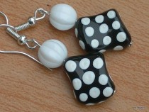 Earrings shaped beads, a white dot on a black base with white bead